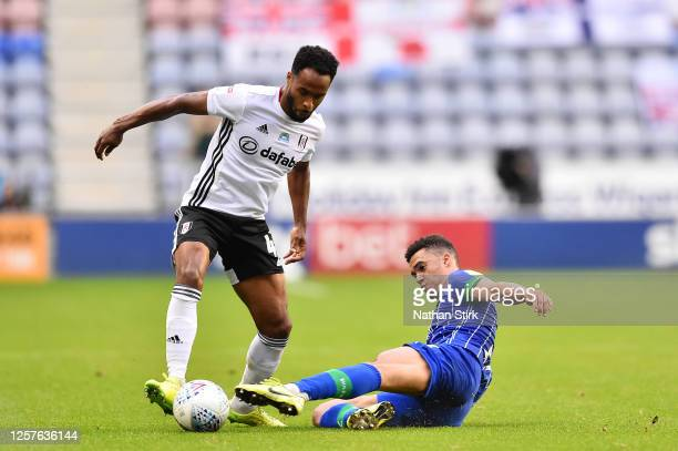 Antonee Robinson of Wigan Athletic tackles Denis Odoi of Fulham during the Sky Bet Championship match between Wigan Athletic and Fulham at DW Stadium...