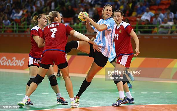 Antonela Mena of Argentina is challenged by Daria Dmitrieva of Russia and Mayya Petrova of Russia during the Womens Preliminary Group B match between...