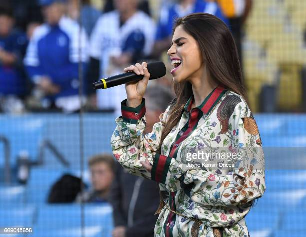 Antonella Barba sings the National Anthem before the game between the Los Angeles Dodgers and the Arizona Diamondbacks at Dodger Stadium on April 14...