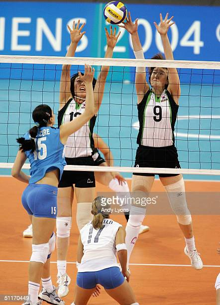 Antonella del Core of Italy hits the ball while defended by Young Dae Jung and Yun So Chang of Korea in the women's indoor Volleyball preliminary...