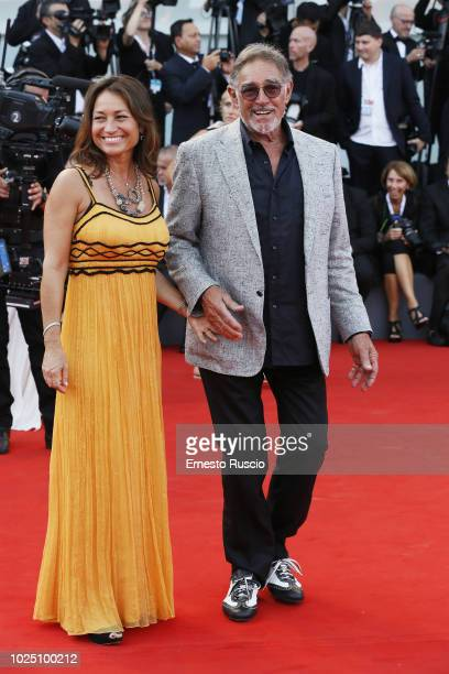 Antonella Liguori and Fabio Testi walk the red carpet ahead of the opening ceremony and the 'First Man' screening during the 75th Venice Film...