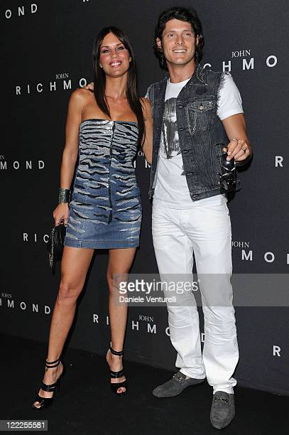 Antonella Mosetti and Aldo Montano attend the John Richmond Milan Menswear Spring/Summer 2011 show on June 21 2010 in Milan Italy