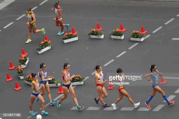 Antonella Palmisano of Italy sets the pace from eventual winner Maria Perez of Spain in the Women's 20km Race Walk during day five of the 24th...