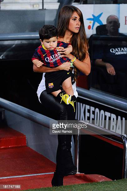 Antonella Roccuzzo and her son Thiago Messi walk onto the pitch prior to the La Liga match between FC Barcelona and Real Sociedad de Futbol at Camp...