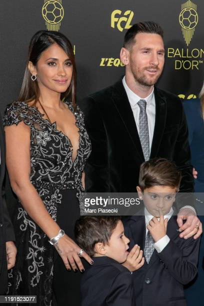 Antonella Roccuzzo and husband Lionel Messi attend the photocall during the Ballon D'Or Ceremony at Theatre Du Chatelet on December 02 2019 in Paris...