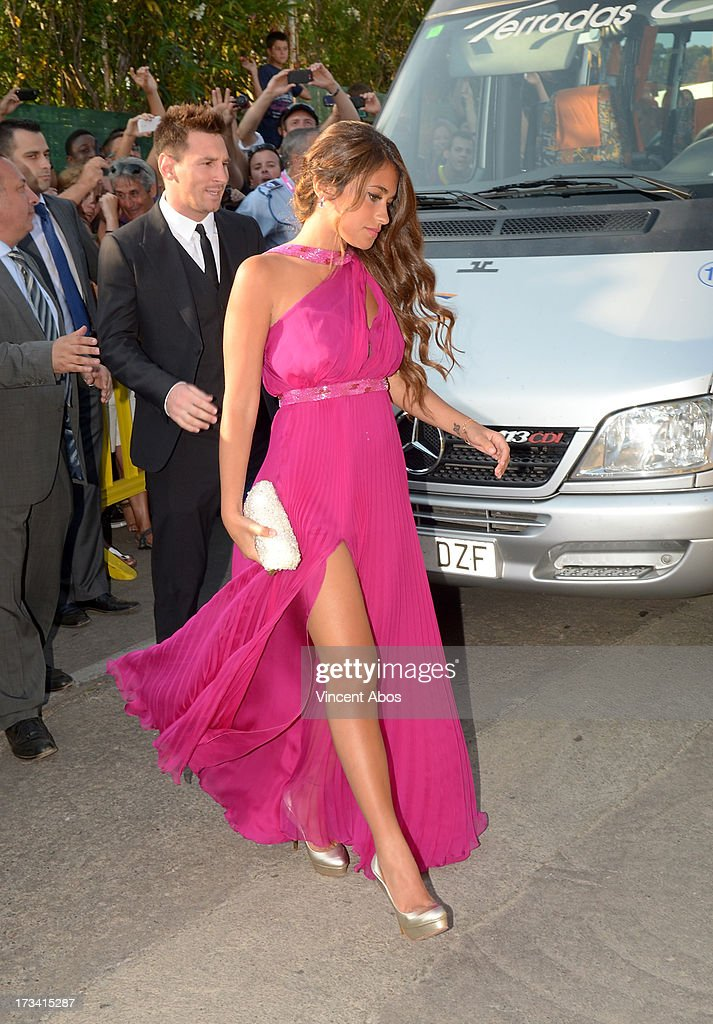 Antonella Roccuzzo and Lionel Messi arrive to the wedding of Xavi Hernandez and Nuria Cunillera at the Marimurtra Botanical Gardens on July 13, 2013 in Barcelona, Spain.