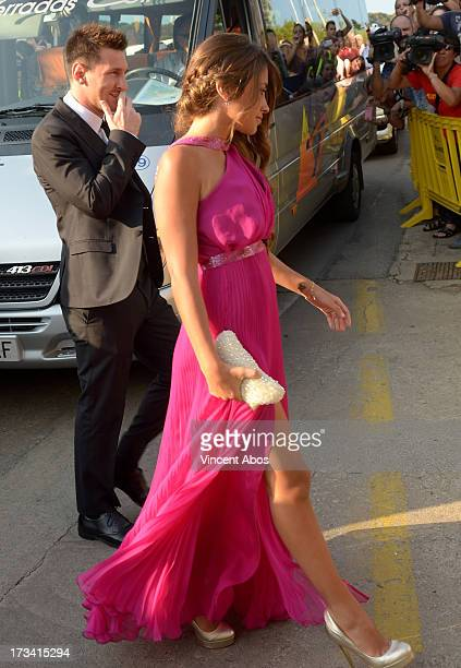 Antonella Roccuzzo and Lionel Messi arrive to the wedding of Xavi Hernandez and Nuria Cunillera at the Marimurtra Botanical Gardens on July 13 2013...