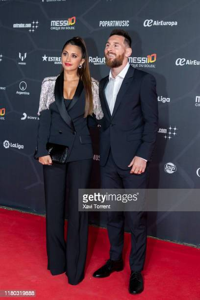 Antonella Roccuzzo and Lionel Messi pose on the red carpet during the premiere of 'Messi 10' by Cirque du Soleil on October 10 2019 in Barcelona Spain
