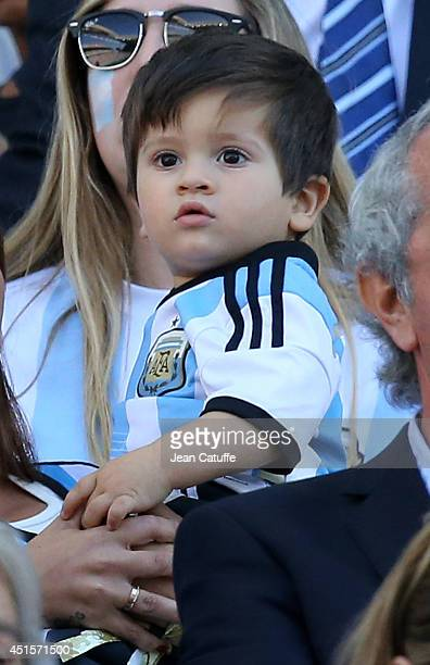 Antonella Roccuzzo girlfriend of Lionel Messi and their son Thiago Messi attend the 2014 FIFA World Cup Brazil Round of 16 match between Argentina...