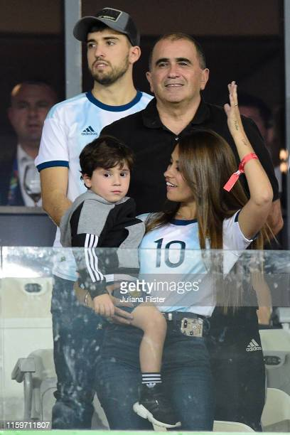 Antonella Roccuzzo wife of Lionel Messi gestures with her son Mateo Messi from the stands during the Copa America Brazil 2019 Semi Final match...