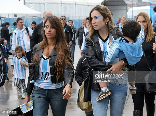 Antonella Roccuzzo wife of Lionel Messi of Argentina attends with her son Thiago Messi carried by a nurse the 2014 FIFA World Cup Brazil Semi Final...