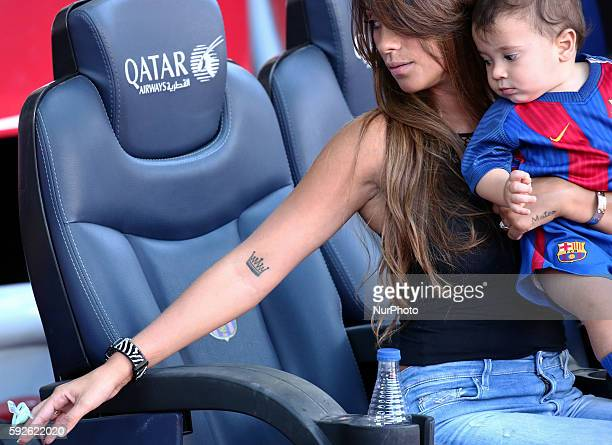 Antonella Roccuzzothe wife of Leo Messi with his son Mateo showing his tattoo during La Liga match between FC Barcelona v Betis in Barcelona on...