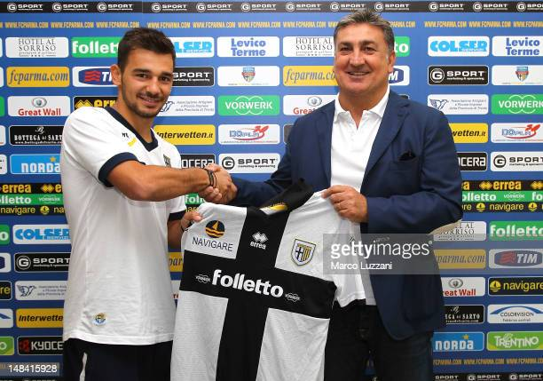 Antonello Preiti and new signing Sotiris Ninis during an unveiling press conference during day three of the Parma FC pre-season training camp on July...