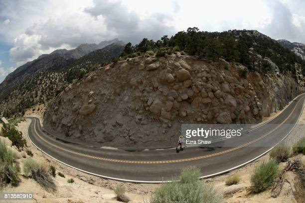 Antonette Prather walks to the Whitney Portal with a member of her support crew during the STYR Labs Badwater 135 on July 12 2017 in Death Valley...
