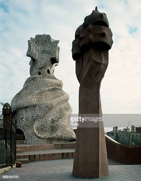 Antoni Gaudi Catalan architect The Pedrera or Casa Mila Roof detail lined with trencadis and enlivened by undulating forms Barcelona Spain