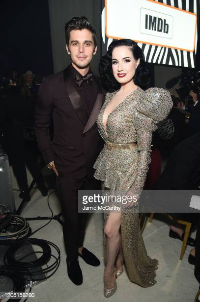 Antoni Porowski and Dita Von Teese attend the 28th Annual Elton John AIDS Foundation Academy Awards Viewing Party sponsored by IMDb, Neuro Drinks and...