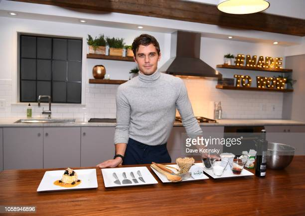 Antoni Porowski demonstrates preparing a signature dish as he attends Boursin Friendsgiving at Home Studios on November 7 2018 in New York City