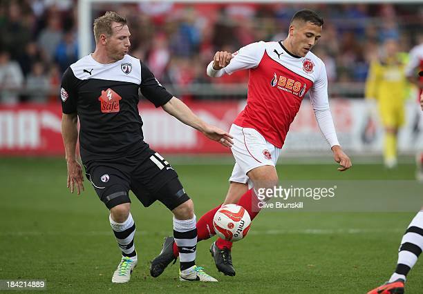 Antoni Sarcevic of Fleetwood Town attempts to move away from Ritchie Humphreys of Chesterfield during the Sky Bet League Two match between Fleetwood...