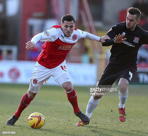 Antoni Sarcevic of Fleetwood Town attempts to move forward with the ball way from Darren Carter of Northampotn Town during the Sky Bet League Two...