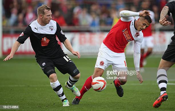 Antoni Sarcevic of Fleetwood Town moves away from Ritchie Humphreys of Chesterfield during the Sky Bet League Two match between Fleetwood Town and...