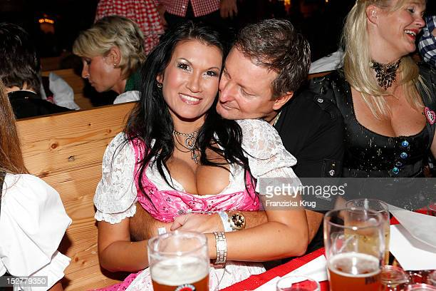 Antonia aus Tirol and Peter Schutti attend the 'Goldstar TV Wiesn' as part of the Oktoberfest beer festival at Weinzelt on September 25, 2012 in...