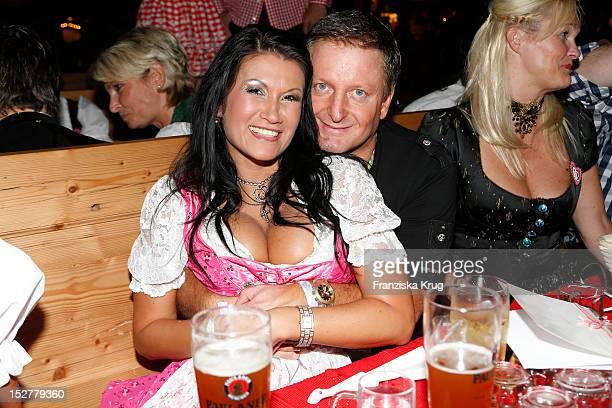 Antonia aus Tirol and Peter Schutti attend the 'Goldstar TV Wiesn' as part of the Oktoberfest beer festival at Weinzelt on September 25 2012 in...
