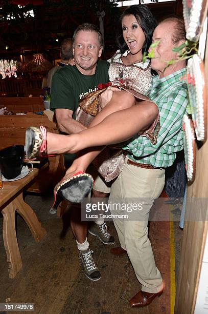 Antonia aus Tirol and Peter Schutti attend the 'Goldstar TV Wiesn' as part of the Oktoberfest beer festival at Weinzelt at Theresienwiese on...