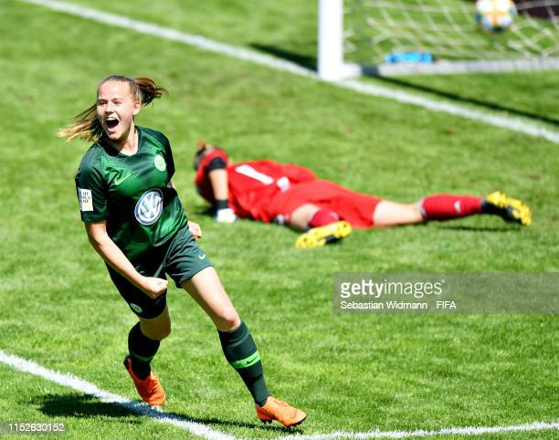 Antonia Baass of VFL Wolfsburg celebrates after scoring her sides second goal in the group stage match between Vancouver Whitecaps and VFL Wolfsburg...