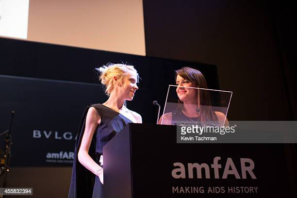 Antonia Campbellhughes and Michelle Ryan appear on stage during the amfAR Milano 2014 Gala Dinner and Auction as part of Milan Fashion Week...