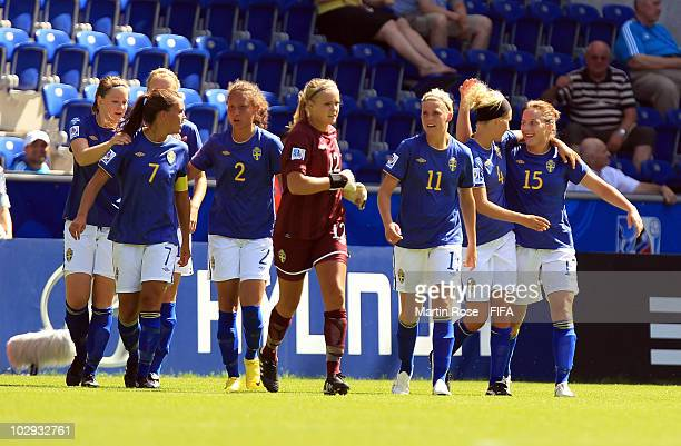 Antonia Goransson of Sweden celebrates with her team mates after scoring her team's opening goal during the 2010 FIFA Women's World Cup Group B match...