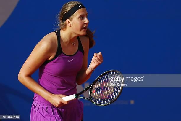 Antonia Lottner of Germany celebrates after defeating Laura PousTio of Spain during their qualifier match on Day One of the Nuernberger...
