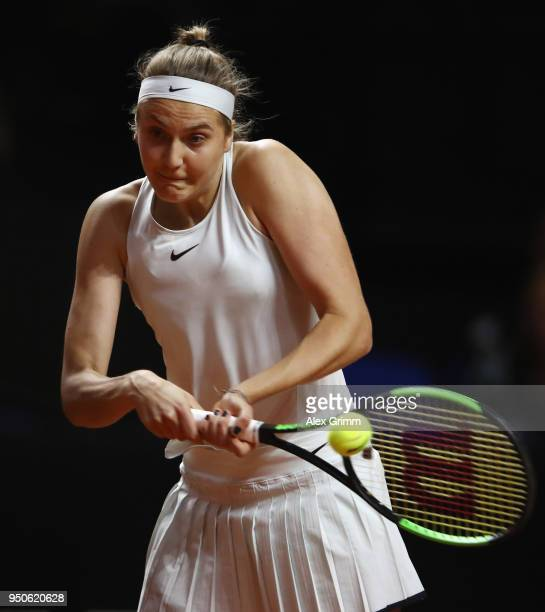 Antonia Lottner of Germany plays a backhand to Marta Kostyuk of Ukraine on day 2 of the Porsche Tennis Grand Prix at PorscheArena on April 24 2018 in...