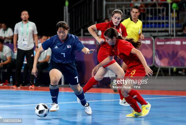 Antonia Martinez of Spain challenges Mai Miyamoto of Japan in the Women's Futsal semi final match between Spain and Japan during the Buenos Aires...