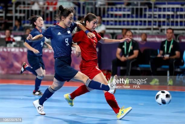 Antonia Martinez of Spain challenges Rikako Yamakawa of Japan in the Women's Futsal semi final match between Spain and Japan during the Buenos Aires...