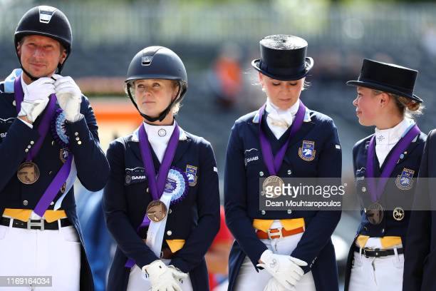 Antonia Ramel, Therese Nilshagen, Juliette Ramel and Patrik Kittel of Sweden celebrate winning the bronze medal during Day 2 of in the Dressage Grand...