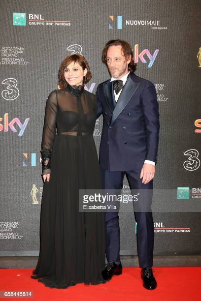 Antonia Truppo and Massimiliano Rossi walk the red carpet of the 61 David Di Donatello on March 27 2017 in Rome Italy