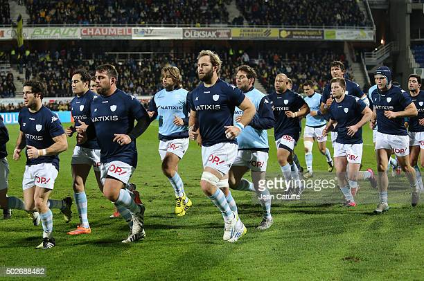 Antonie Claasen of Racing 92 and teammates warm up before the Top 14 rugby match between ASM Clermont Auvergne and Racing 92 at Stade Marcel Michelin...