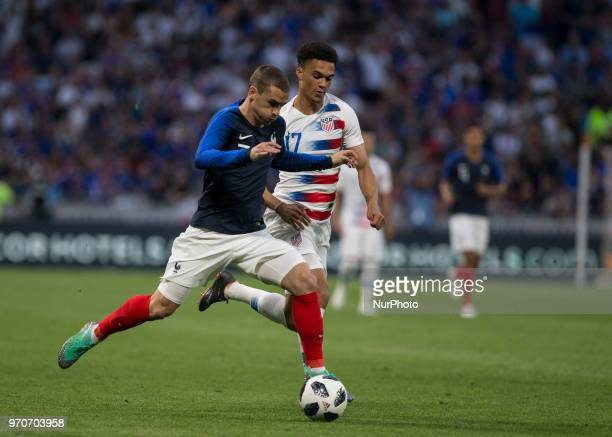 Antonie Griezmann of France vies Antonee Robinson of USA during the friendly football match between France and USA at the at the Parc Olympique...
