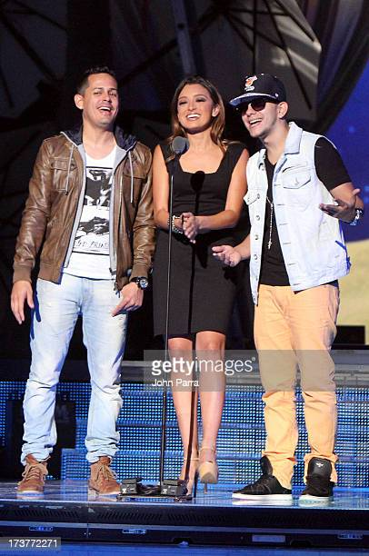Antonietta Collins speaks onstage with Angel y Khriz during rehearsal for Premios Juventud 2013 at Bank United Center on July 17 2013 in Miami Florida