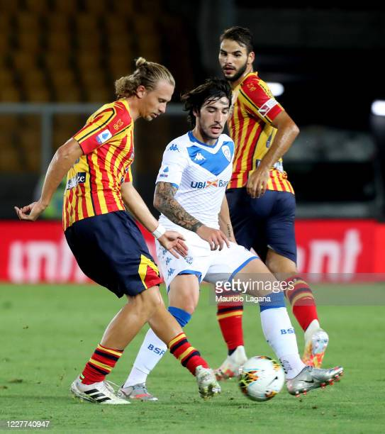 Antonin Barak of Lecce competes for the ball with Sandro Tonali of Brescia during the Serie A match between US Lecce and Brescia Calcio at Stadio Via...