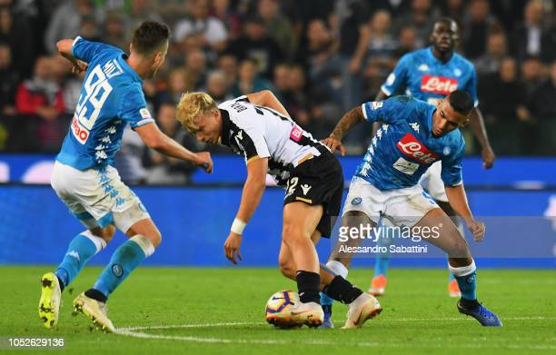 Antonin Barak of Udinese Calcio competes for the ball with Allan of SSC Napoli during the Serie A match between Udinese and SSC Napoli at Stadio...