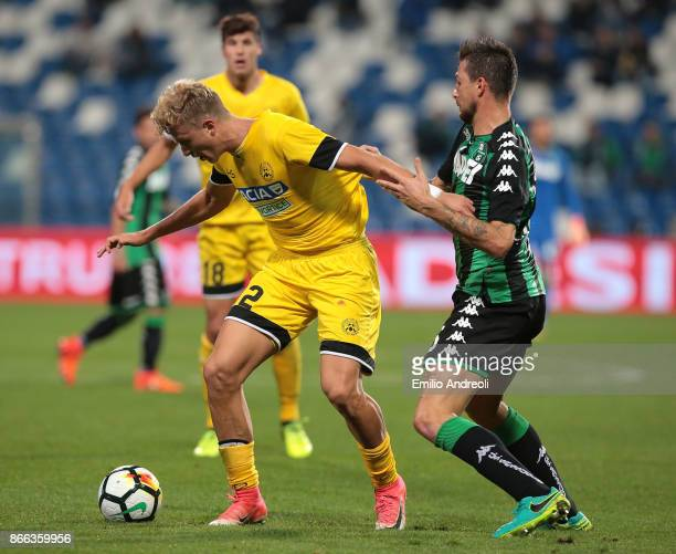 Antonin Barak of Udinese Calcio competes for the ball with Francesco Acerbi of US Sassuolo Calcio during the Serie A match between US Sassuolo and...