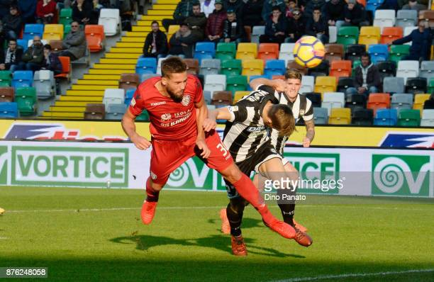 Antonin Barak of Udinese Calcio competes with Leonardo Pavoletti of Cagliari Calcio during the Serie A match between Udinese Calcio and Cagliari...