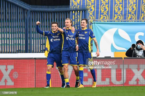 Antonin Barak of Verona celebrates with team mates Darko Lazovic and Ivan Ilic after scoring their side's second goal during the Serie A match...