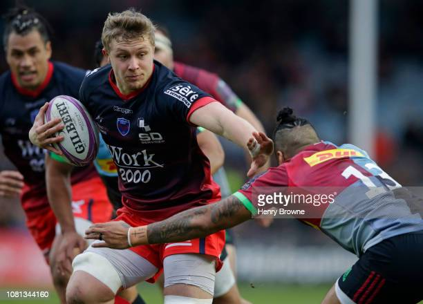 Antonin Berruyer of Grenoble pushes off Alofa Alofa of Harlequins during the Challenge Cup match between Harlequins and Grenoble Rugby at Twickenham...