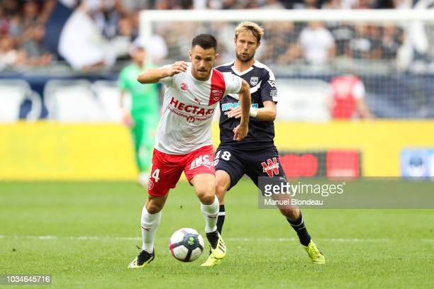 Antonin Bobichon of Nimes and Jaroslav Plasil of Bordeaux during the French Ligue 1 match between Bordeaux and Nimes on September 16 2018 in Bordeaux...