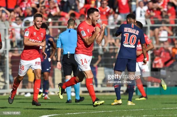 Antonin Bobichon of Nimes ceelbrates his scoring during the Ligue 1 match between Nimes and Paris Saint Germain on September 1 2018 in Nimes France
