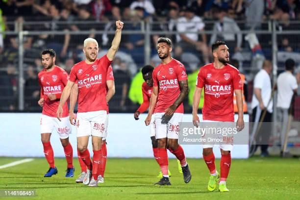 Antonin Bobichon of Nimes celebrates his scoring with team-mates during the Ligue 1 match between Nimes and Lyon on May 24, 2019 in Nimes, France.