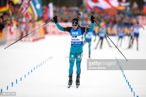 Antonin Guigonnat of France celebrates at the finish line during the men's mass start event of the Biathlon World Cup at the Chiemgau Arena in...