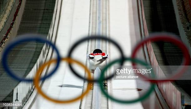 Antonin Hajek from the Czech Republic is seen through the Olympic Rings during a Men's Large Hill training session in RusSki Gorki Jumping Center at...